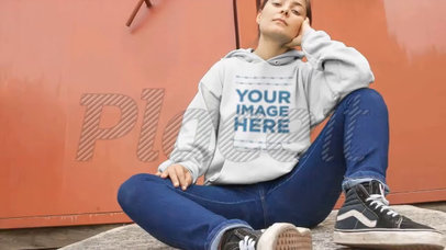 Woman Sitting Down With Legs Open Wearing a Pullover Hoodie Video a13116