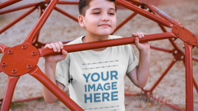 Boy Playing at the Jungle Gym Wearing a Round Neck Tee Video Mockup a12774
