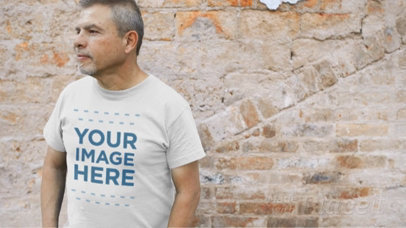 Middle Aged Man Standing Near an Old Bricks Wall Wearing a T-Shirt Video Mockup a12748