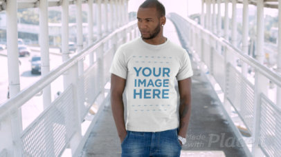 Stylish Black Man Waiting on a City Bridge Wearing a T-Shirt Video Mockup 12876b