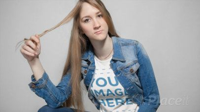 Lovely Girl Twirling her Hair while Wearing a T-Shirt Cinemagraph Mockup a13301