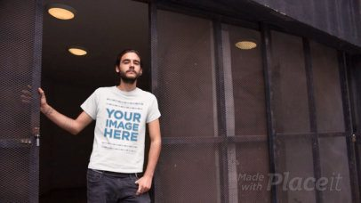Hipster Guy Leaning at the Entrance of a Building T-Shirt Video Mockup a12976