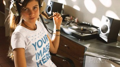 Girl Listening to a Vinyl Record Wearing a Round Neck T-Shirt Cinemagraph Mockup a13322