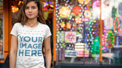 Young Girl Wearing a Round Neck T-Shirt Cinemagraph in Front of a Store With Flashing Lights a13323