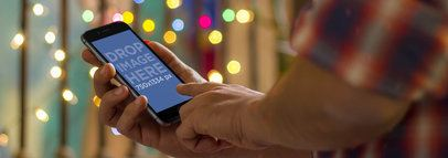 Man Using iPhone 6 During Christmas Wide