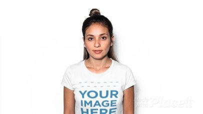 Hispanic Girl with a Hair Bun Wearing a Round Neck Tee Stop Motion Video Against a White Background a13240