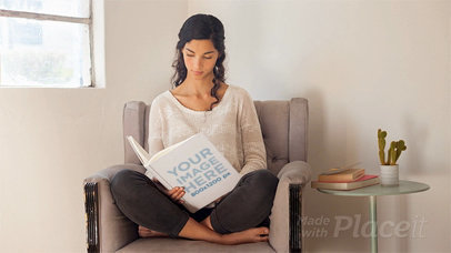 Pretty Girl Reading a Book While Sitting On Her Armchair in Stop Motion a13677