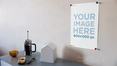 Moving Objects On a Table Below a Poster on the Wall in Stop Motion a13649