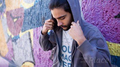 Trendy Guy Wearing a Round Neck T-Shirt Stop Motion Near a Graffiti Street Wall a13440
