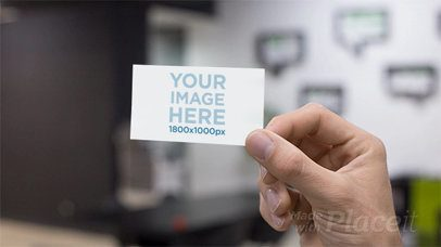 Closeup of a Business Card Stop Motion Being Held at an Office a13728