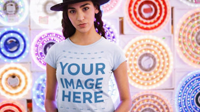 Trendy Girl Wearing a Tshirt Cinemagraph and a Hat Against Flashing Circle Lights a13326