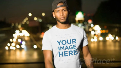Handsome Black Man Wearing a T-Shirt Video Mockup in the City at Night a13507