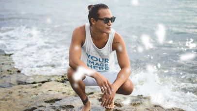 Surfer Guy Wearing a Tank Top Cinemagraph Mockup at a Rocky Shore a13754