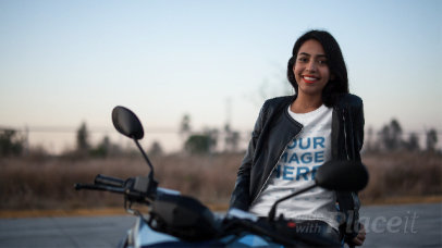 Smiling Biker Girl Wearing a T-Shirt Stop Motion and a Leather Jacket Outdoors a13581