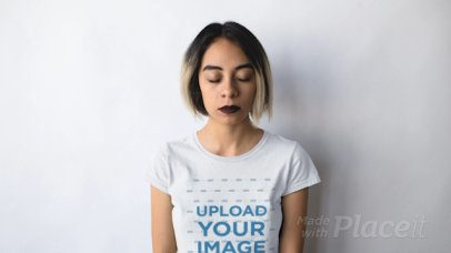 Edgy Girl With Paper Airplane Circling Her Head Wearing a Round Neck Tee Stop Motion Mockup a13604b
