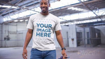Middle Aged Black Man Wearing a Round Neck Tee Video Mockup in a Warehouse a13120