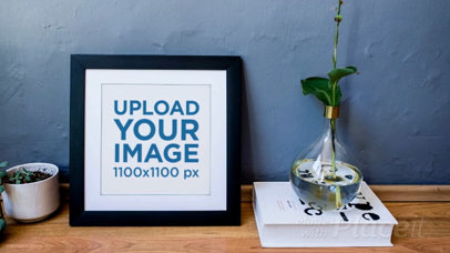 Video Mockup of a Squared Frame Leaning Over a Grey Wall a14353