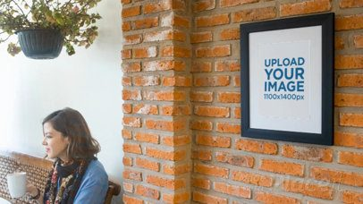 Art Print Video on a Bricks Wall While a Girl Is Texting on Her Phone Nearby a14354
