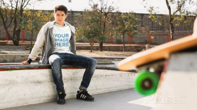 Young White Man Wearing a T-Shirt Cinemagraph Sitting at a Skating Park a13500