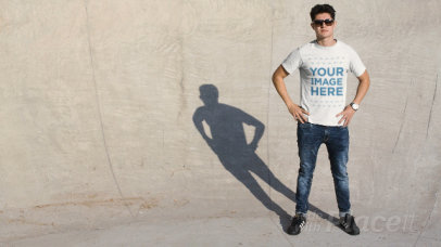 Man Wearing a T-Shirt Cinemagraph With His Shadow Taking Glasses Off a13498