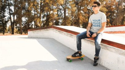 Cinemagraph of a Man Wearing a Round Neck Tee Playing with a Skateboard a13501