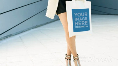 Video Of Beautiful Woman Holding A Tote Bag While In The City Mockup a13908b