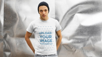 Young Man Wearing a Beanie and T-Shirt Video Inside a Storage Room a13025