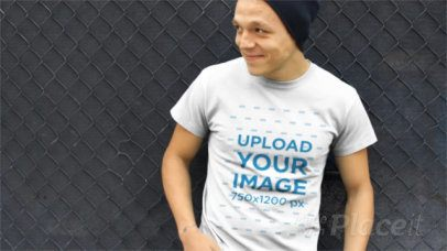 Young Man Wearing a Beanie and T-Shirt Video Hanging Around a13026