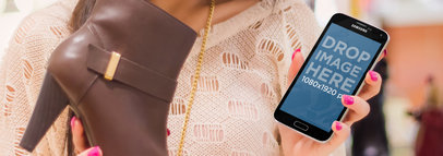 Samsung Galaxy Mockup of a Woman Holding a Shoe Wide