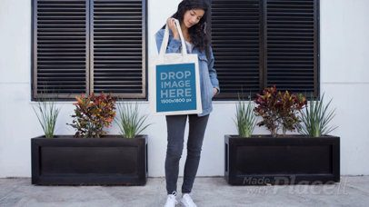 Pretty Girl Holding a Tote Bag Outside Her House in Stop Motion a13645