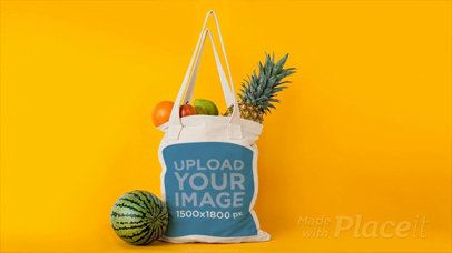 Tote Bag with Fruits Disappearing From It in Stop Motion Against Yellow Background a13711