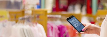 iPhone 6 Mockup of a Woman Shopping for Clothes Wide