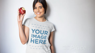 Video of a Beautiful Girl Eating an Apple Wearing a T-Shirt a13230