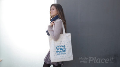 Beautiful Girl Carrying a Tote Bag Video While Lying Against a Black and White Wall a13766