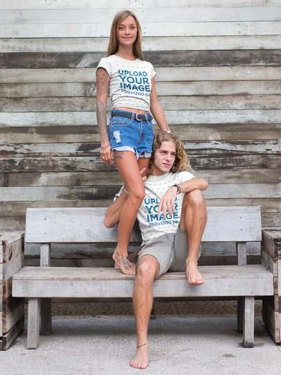 Blonde Couple Wearing Tshirts Mockup on a Wooden Bench a18797