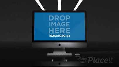 Video of an iMac Standing in a Black Room a15965b