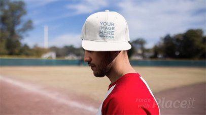 Young Hispanic Man Turning Around Wearing a Hat in Stop Motion at a Baseball Field a13690
