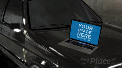 MacBook Pro Video Lying on a Car Hood a16257b