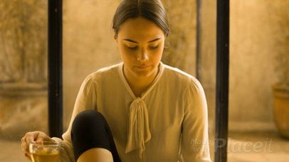 Young Girl Looking at a Book While Drinking a Tea in a Yoga Pose Video a14170