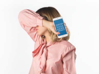 Blonde Woman Holding an iPhone Mockup Covering Her Face a19289