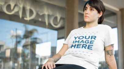 Woman Sitting at a Skate Ring Wearing a Round Neck T-Shirt Video a12643