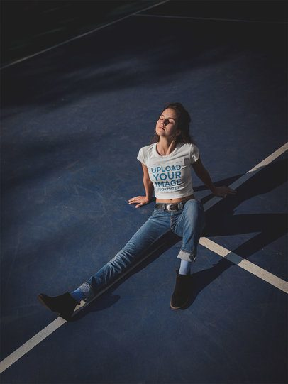 Crop Top Mockup of a Girl Wearing a Tshirt Lying on a Court at Night a19327