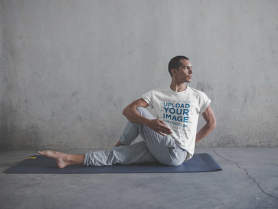 Man Wearing a T-Shirt Mockup Doing a Yoga Pose a19961