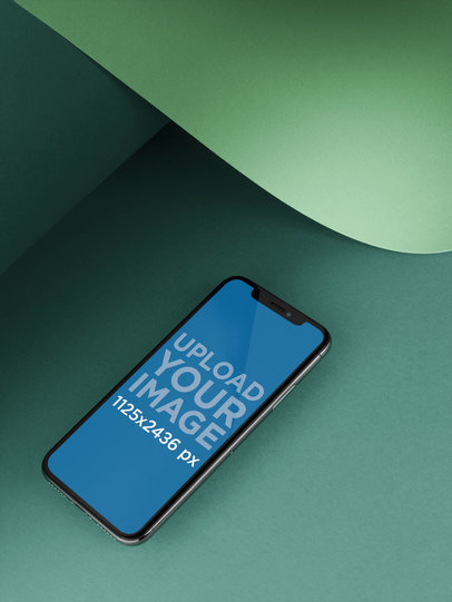 iPhone X Template Lying Below a Bent Pasteboard a20007