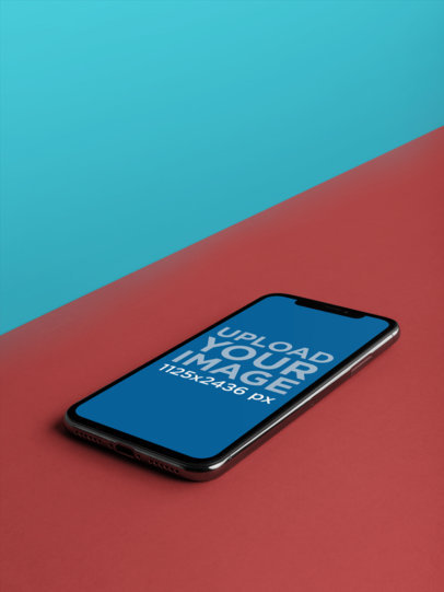 iPhone X Mockup Lying on a Bicolor Surface a20004
