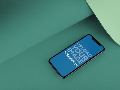 iPhone X Template Lying on a Bent Pasteboard a20008