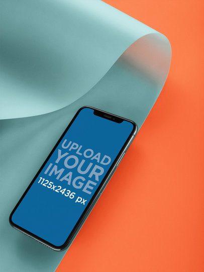 Black iPhone X Mockup Lying on a Bent Semi-Transparent Pasteboard a20088