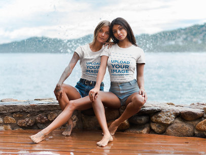 Girlfriends Wearing T-Shirts Mockup Sitting Against the Breaking Waves a18798