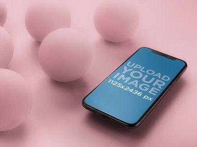 Black iPhone X Mockup Floating Near Balls a20012