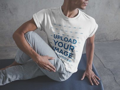 Man Stretching his Legs for the Yoga Class Wearing a T-Shirt Mockup a20030
